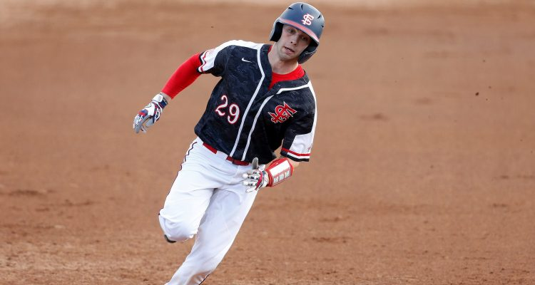 Photo of Fresno State catcher Carter Bins rounding the bases