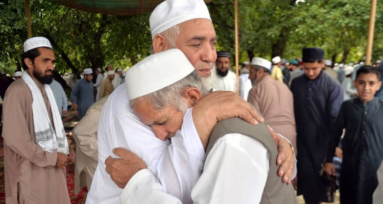 Photo of Pakistani Muslims greeting each other