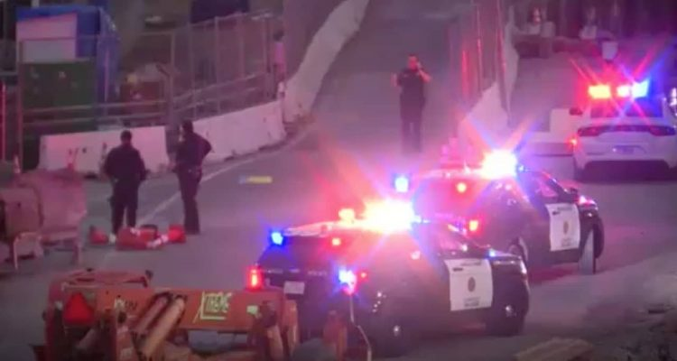 Screenshot of police officers and border agents at the California-Mexico border