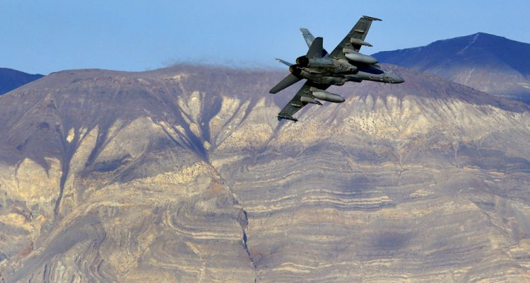 Photo of a U.S. Navy F-18 Super Hornet flying out of Star Wars Canyon in Death Valley, California.
