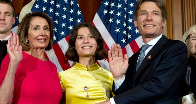 Photo of Nancy Pelosi and Rep. Tom Malinowski during a swearing-in ceremony