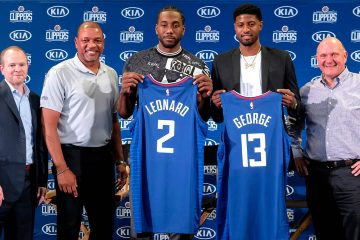 Photo of Kawhi Leonard, center, and Paul George, second right, holding their new team jerseys, with Los Angeles Clippers President of Basketball Operations Lawrence Frank, left, head coach Doc Rivers, second left, and team chairman Steve Ballmer