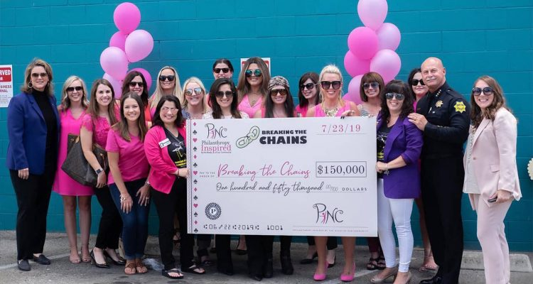Photo of PINC donating $150,000 to Breaking the Chains