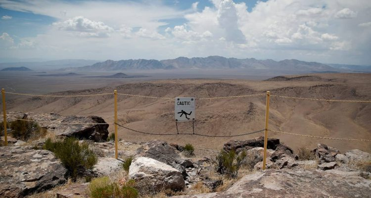 Photo of signs near the crest of Yucca Mountain in Mercury, Nv.