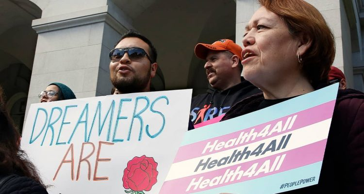 Photo of supporters of proposals to expand health coverage to immigrants in the country illegally
