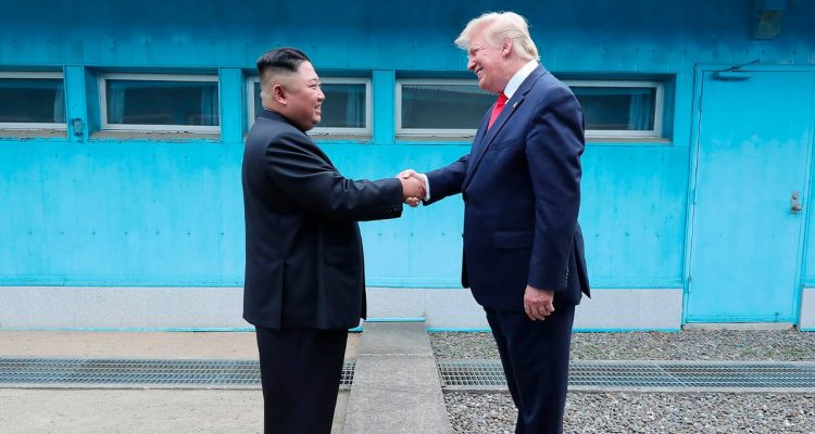 Photo of Kim Jong Un shaking hands with Donald Trump