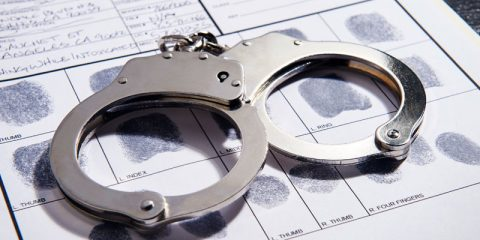 photo of handcuffs on a booking slip