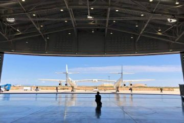 Virgin Galactic ground crew guiding the company carrier plane