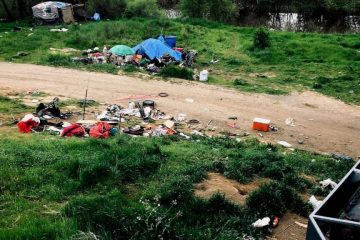 Photo of trash and a homeless tent in Sacramento