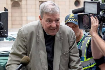 Photo of Cardinal George Pell leaving County Court in Melbourne