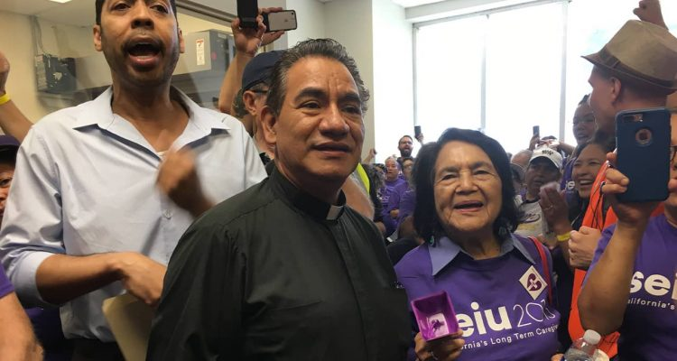 Photo Derek Smith and Dolores Huerta protesting