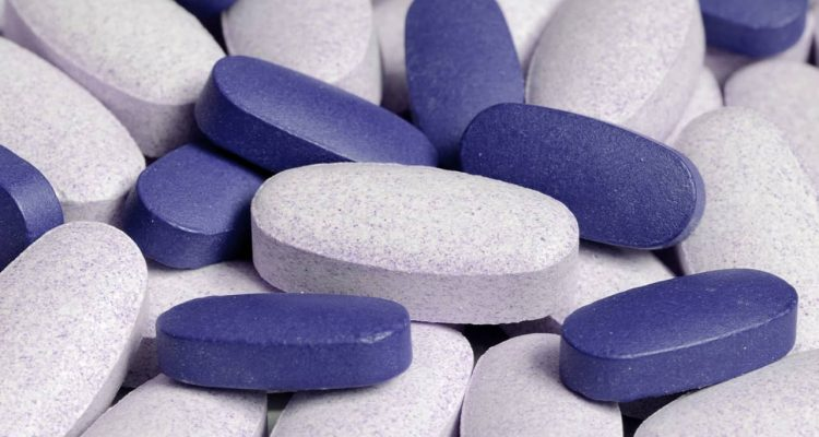 Photo of blue and white pills