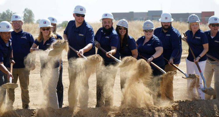 Photo of Madera Unified officials celebrating the start of new construction