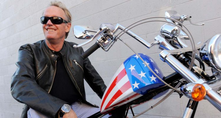 Photo of Peter Fonda on the chopper motorcycle he made famous in Easy RiderDo