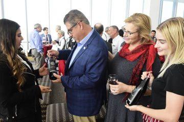 Photo of wine presentation to Fresno State President Joseph Castrohe un