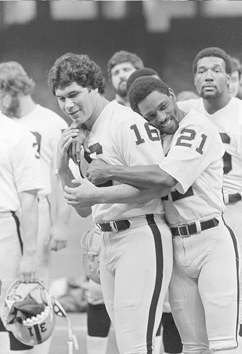 Photo of Cliff Branch hugging Jim Plunkett
