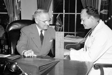 Photo of Brigadier Gen. Wallace Harry Graham, right, personal physician of President Harry S. Truman checking his blood pressure