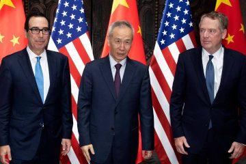 Photo of Chinese Vice Premier Liu He, center, posing with U.S. Trade Representative Robert Lighthizer, right, and Treasury Secretary Steven Mnuchin