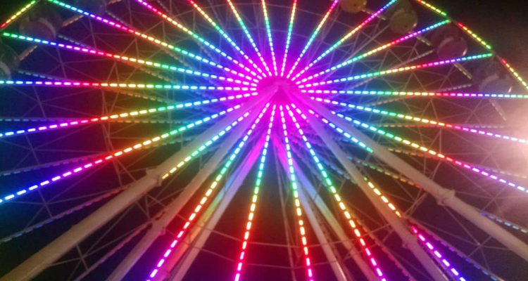 Photo of a ferris wheel at night