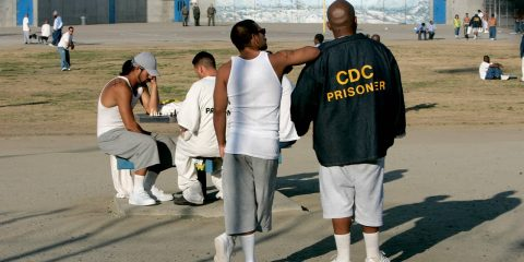 Photo of inmates in the recreation yard at Corcoran State Prison
