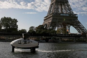 Photo of a SeaBubble going past the Eiffel Tower in Paris