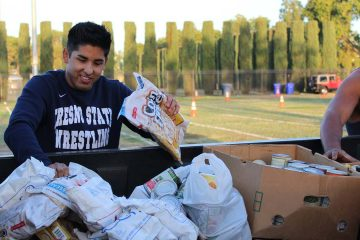 "Photo of Fresno State students help out during the 2018 ""Feed the Need"" food drive for the Student Cupboard"