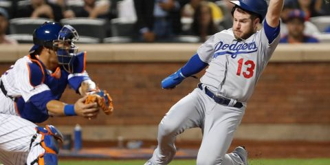 Photo of Max Muncy running home to score