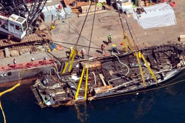 Photo of the Conception being brought out of the water by a salvage team