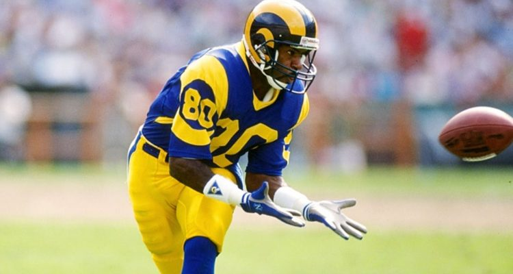 Photo of Henry Ellard preparing to catch a football in a Los Angeles Rams uniform