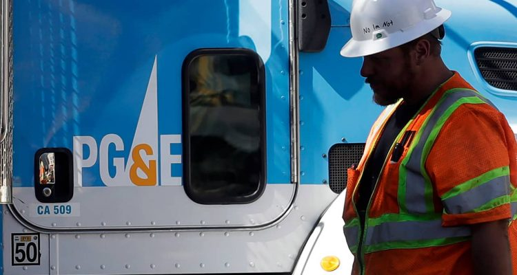 Photo of PG&E worker and PG&E truck