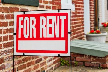 """Photo of a red """"For Rent"""" sign"""