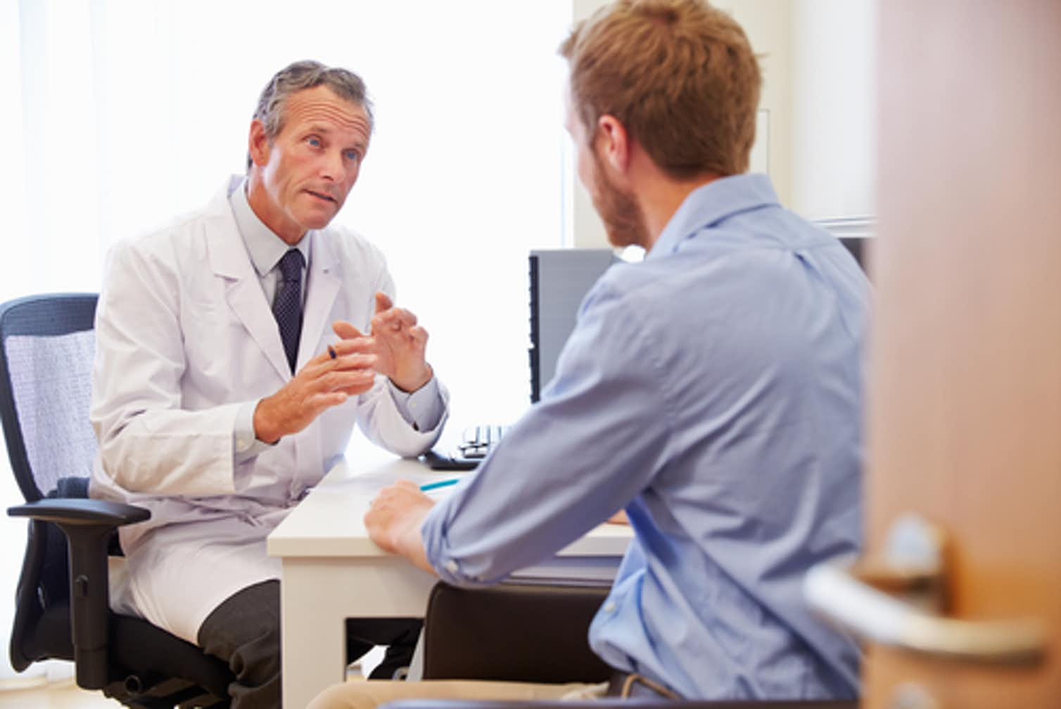Photo of a doctor talking with a patient