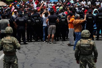 Photo of Mexican authorities stopping a migrant caravan