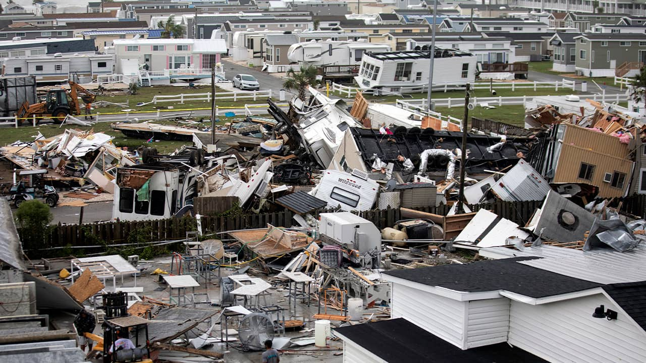 Photo of mobile homes and debris