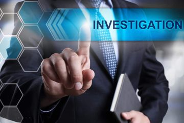 "Photo of a businessman with the word ""investigation"" signifying potential fraud"