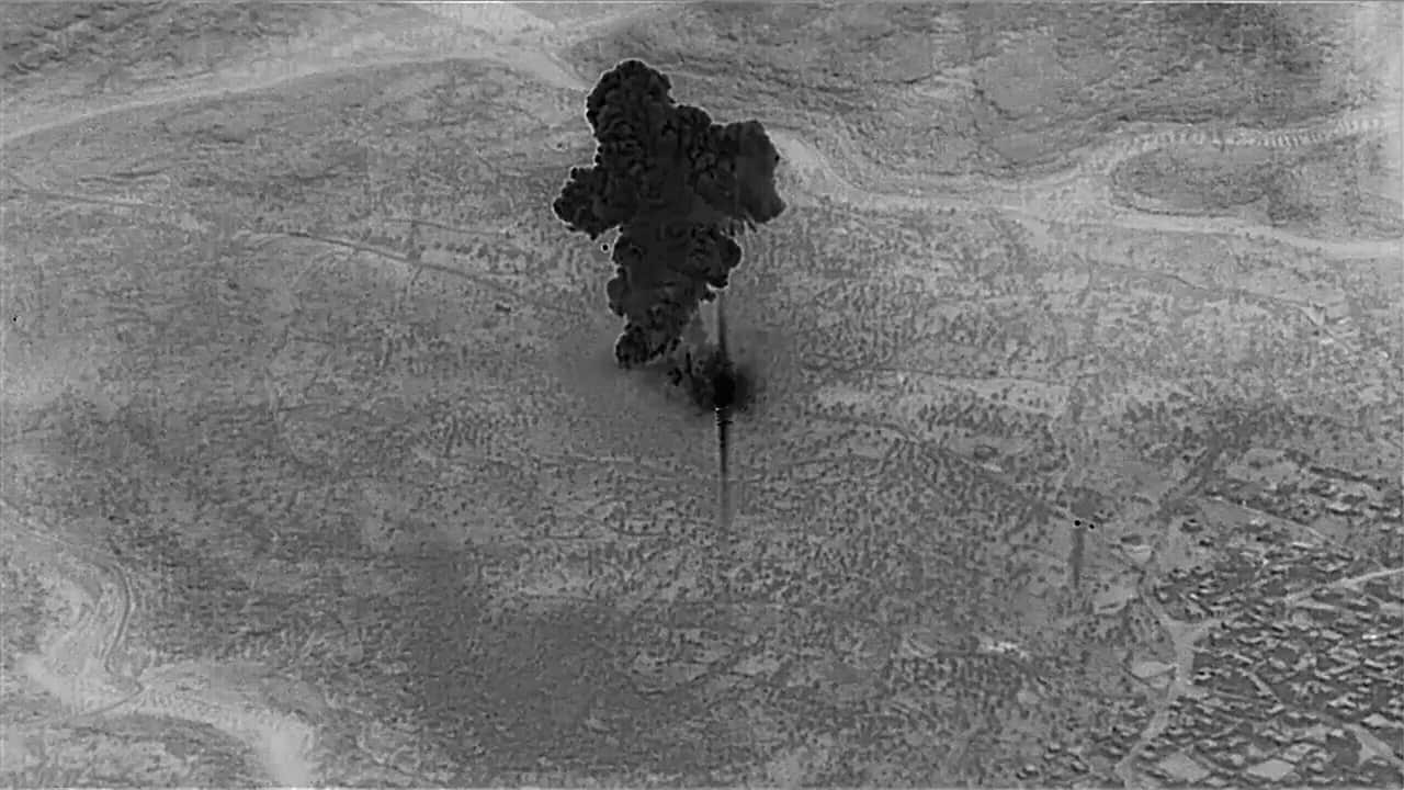Photo of a remotely piloted aircraft focused on the compound of Islamic State leader Abu Bakr al-Baghdadi