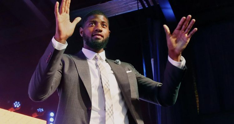 Photo of Paul George in a suit
