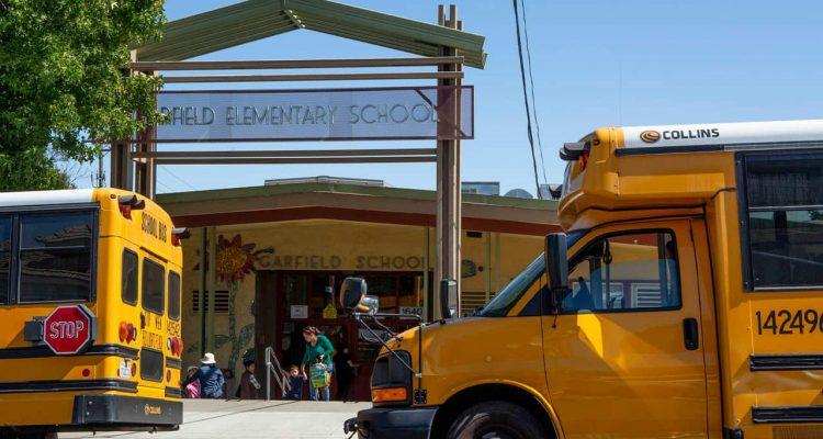 Photo of school buses outside of Garfield Elementary School in Oakland