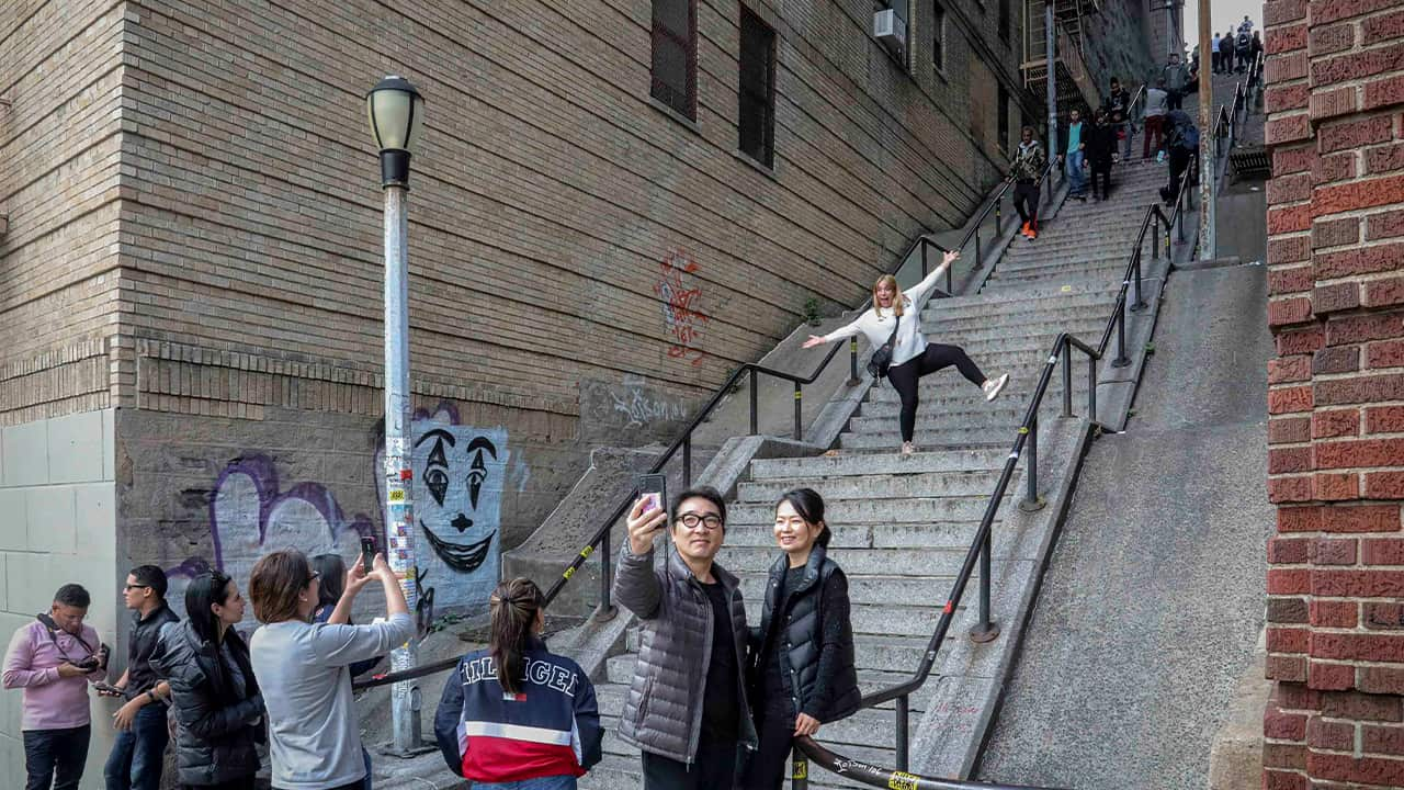 Photo of people posing on the Joker stairs