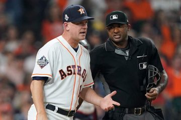 Photo of AJ Hinch arguing a call with an umpire