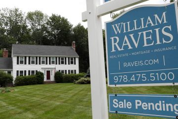 Photo of a home for sale sign