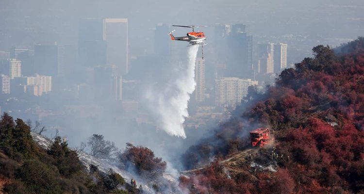 Photo of a helicopter dropping water on the Getty Fire