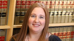 Photo of Jodie Howard in a law library