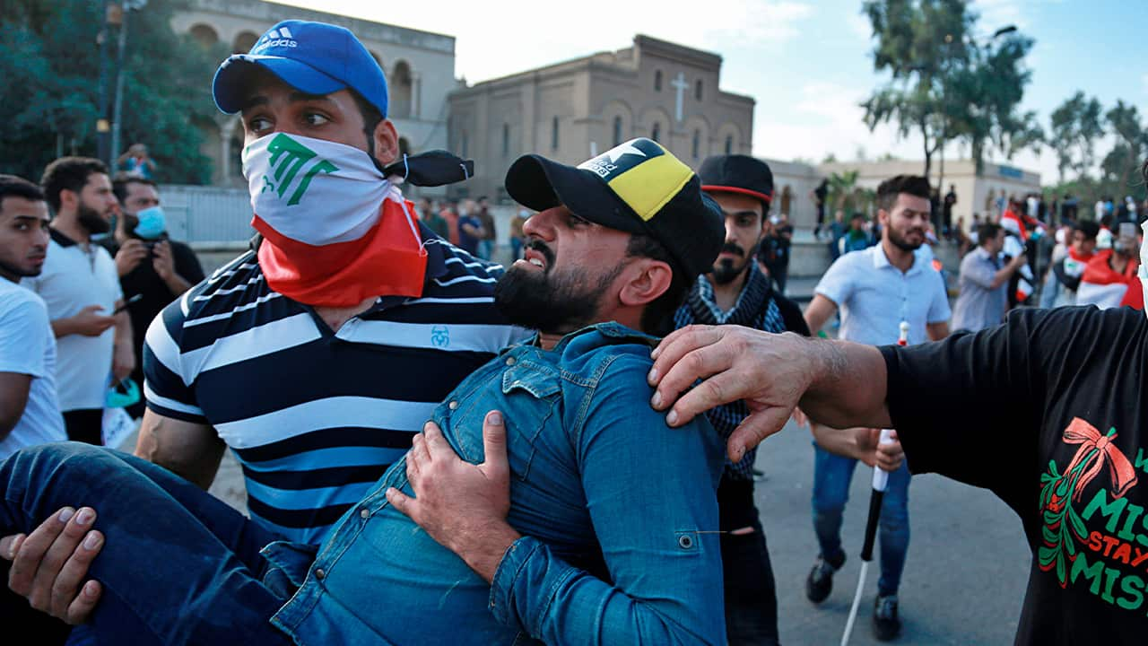 Photo of an injured protestor being carried