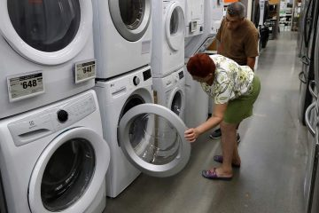 Photo of a woman examining washers