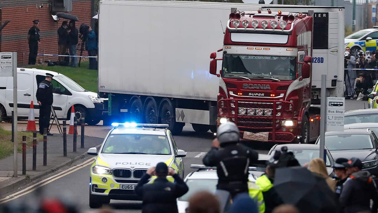 Photo of police escorting a truck