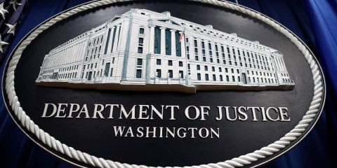Photo of a sign for the Department of Justice