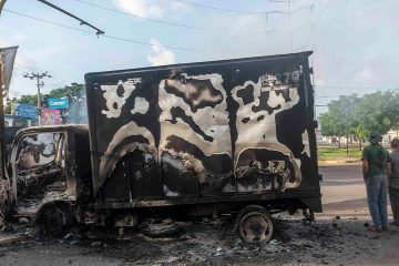 Photo of a burnt out truck in Mexico