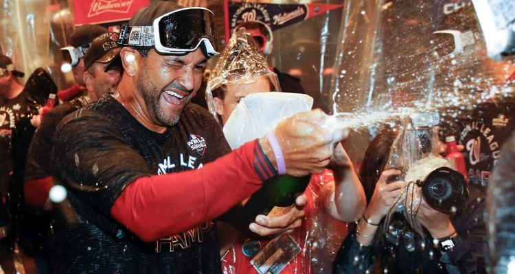 Photo of Washington Nationals manager Dave Martinez celebrating