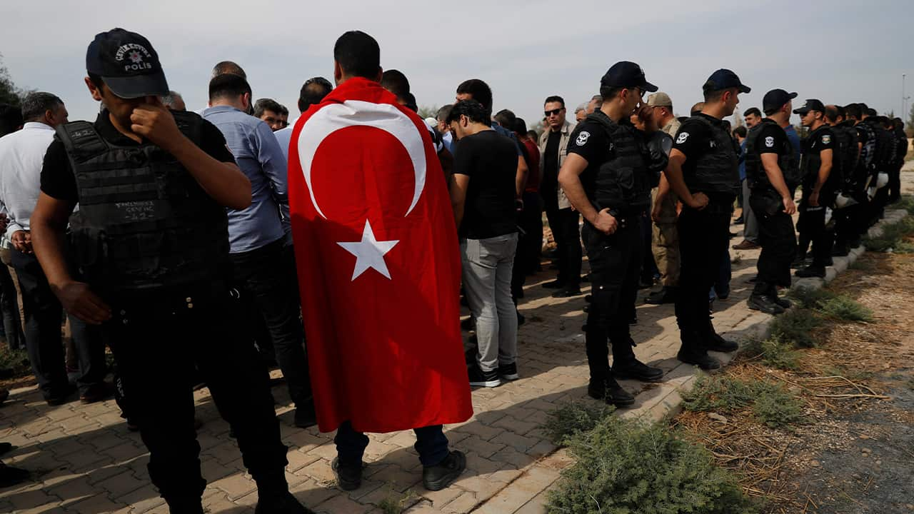 Photo of Turkish police officers securing the area